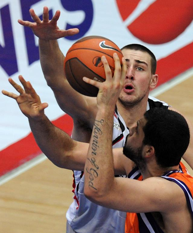 Valencia's Vitor Faverani (R) vies with Lietuvos Rytas's Jonas Valanciunas during an Eurocup semi-final basketball match between Valencia and Lietuvos Rytas in Khimki, outside Moscow, on April 14, 2012. AFP PHOTO / KIRILL KUDRYAVTSEV (Photo credit should read KIRILL KUDRYAVTSEV/AFP/Getty Images)