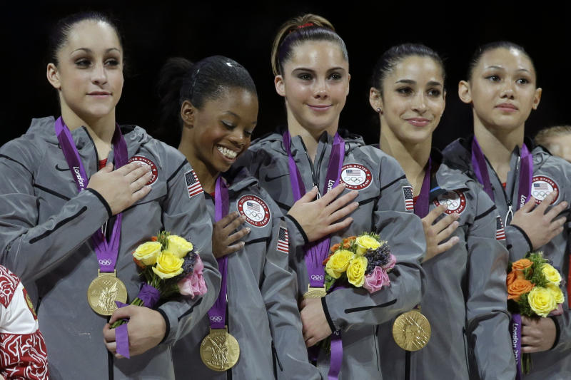 U.S. gymnasts, left to right, Jordyn Wieber, Gabrielle Douglas, McKayla Maroney, Alexandra Raisman and Kyla Ross stand for their national anthem, during the Artistic Gymnastics women's team final at the 2012 Summer Olympics, Tuesday, July 31, 2012, in London. (AP Photo/Julie Jacobson)