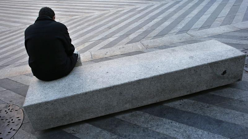 A man sits on a bench in central Madrid