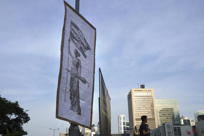 "A sign reading: ""Free Hong Kong, Democracy Now"" hangs from a pole during a protest opposing the recent firings of Cathay Pacific employees in Hong Kong, Wednesday, Aug. 28, 2019. Trade union members in Hong Kong rallied against the city's flagship Cathay Pacific airline for firing employees apparently because of links to this summer's ongoing pro-democracy protests. (AP Photo/Vincent Yu)"