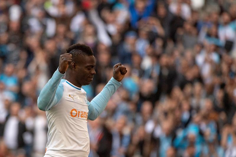 Marseille's Italian forward Mario Balotelli celebrates after scoring a goal during the French L1 football match OM vs Angers at the Velodrome stadium on March 30, 2019. (Photo by Christophe SIMON / AFP) (Photo credit should read CHRISTOPHE SIMON/AFP/Getty Images)