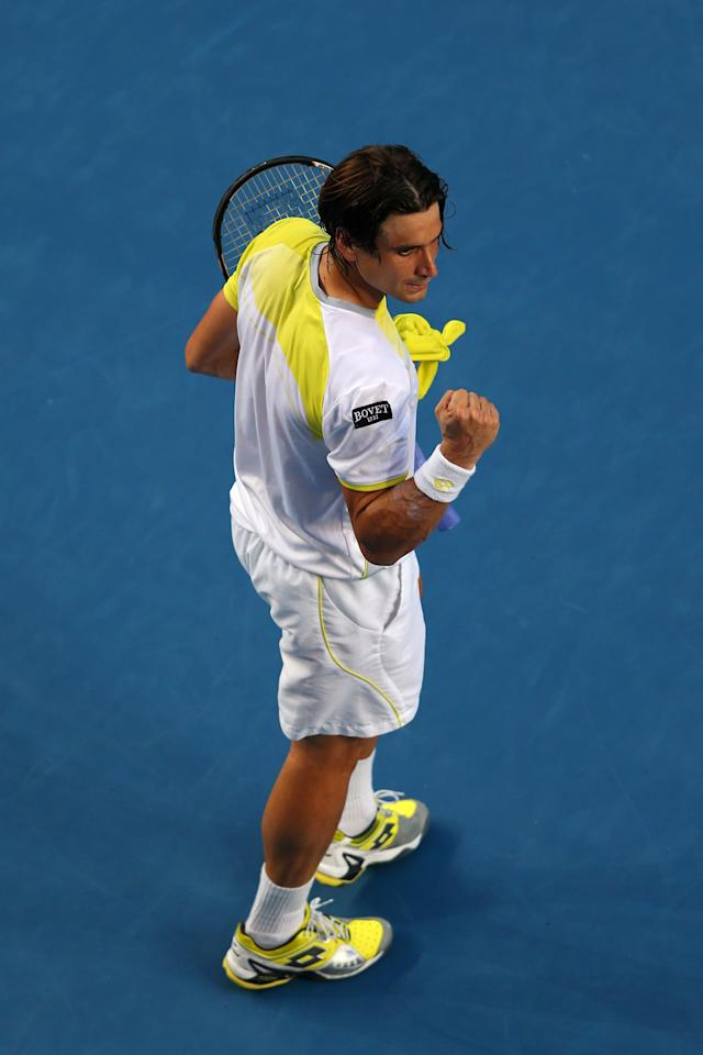 MELBOURNE, AUSTRALIA - JANUARY 14:  David Ferrer of Spain celebrates winning his first round match against Olivier Rochus of Belgium during day one of the 2013 Australian Open at Melbourne Park on January 14, 2013 in Melbourne, Australia.  (Photo by Julian Finney/Getty Images)