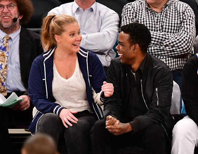 <p>The newly married funny lady shared some laughs with her pal (and probably dished some wedding details) courtside as the New York Knicks took on the Golden State Warriors at Madison Square Garden on Monday in NYC. (Photo: James Devaney/Getty Images) </p>