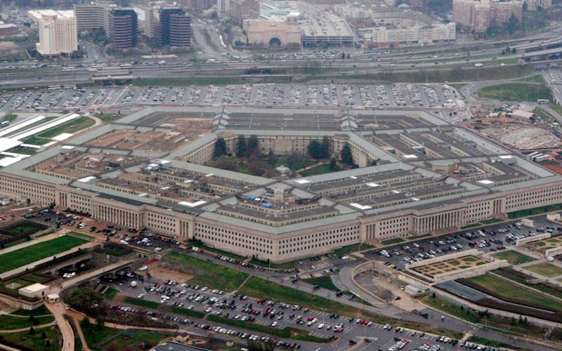 A Pentagon official said transgender people can enlist in the military beginning Jan. 1, despite President Donald Trump's opposition - AP