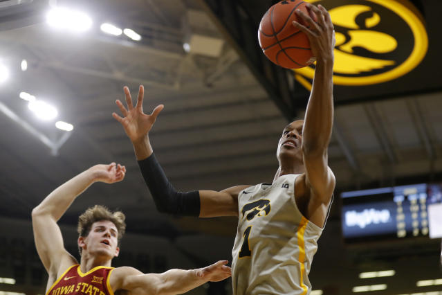 Iowa guard Maishe Dailey, right, grabs a rebound over Iowa State forward Michael Jacobson, left, during the first half of an NCAA college basketball game, Thursday, Dec. 6, 2018, in Iowa City, Iowa.(AP Photo/Charlie Neibergall)
