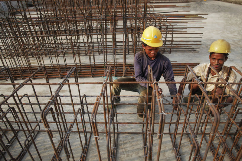 Local workers employed by Indian conglomerate Essar Group construct a new port in Sittwe