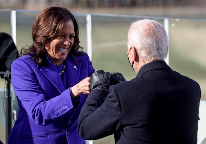 Vice President Kamala Harris fist bumps President-elect Joe Biden after she was sworn in at their inauguration on the West Front of the U.S. Capitol on January 20, 2021 in Washington, DC. (Photo by Jonathan Ernst-Pool/Getty Images)