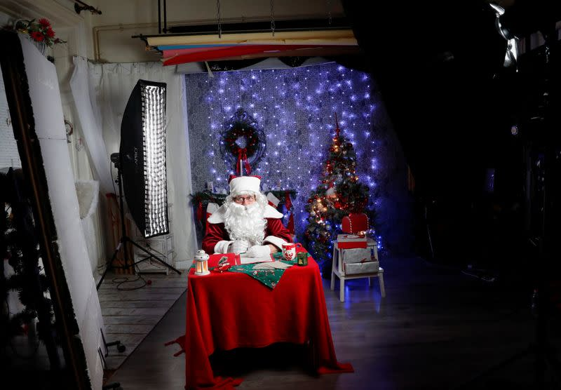 Nemes, dressed as Santa, prepares to interact with children by video in a photo studio, amid the COVID-19 outbreak in Budapest