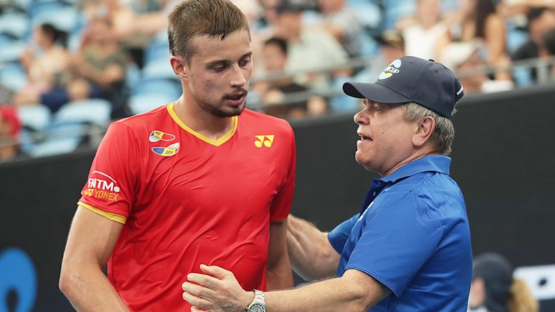 Alexander Cozbinov of Moldova celebrates winning set point with Moldova team captain Vladimir Albot, after a gaffe from organisers before the match saw the Romanian national anthem player, instead of the Moldova national song. (Photo by Mark Metcalfe/Getty Images)