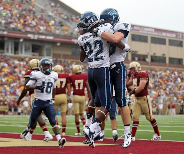 Villanova wide receiver Jamal Abdur-Rahman (22) is congratulated by teammate Kevin Gulyas, right, after scoring a touchdown ion the first half of an NCAA college football game against Boston College, Saturday, Aug. 31, 2013, in Boston. (AP Photo/Mary Schwalm)