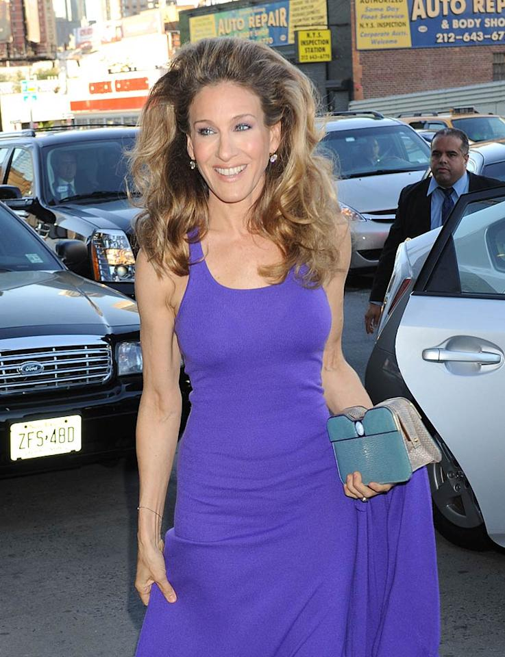 """I absolutely love """"Sex and the City"""" star Sarah Jessica Parker. I also happen to adore her blue Fendi clutch and the purple Halston Heritage dress she wore to the recent Robin Hood Foundation benefit in NYC. However, I abhor her lioness-like hairdo, which unfortunately overshadowed what could have been a lovely look. Demis Maryannakis/<a href=""""http://www.splashnewsonline.com"""" target=""""new"""">Splash News</a> - May 9, 2011"""
