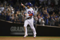 Chicago Cubs' Willson Contreras celebrates while rounding the bases after hitting a solo home run during the eighth inning of a baseball game against the Cleveland Indians Tuesday, June 22, 2021, in Chicago. Chicago won 7-1. (AP Photo/Paul Beaty)