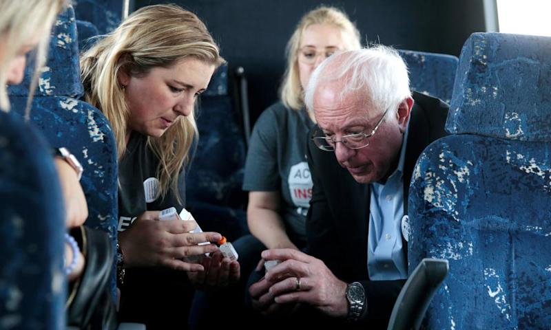 Sanders talks with type 1 diabetes advocate Quinn Nystrom as they ride the bus across the border.