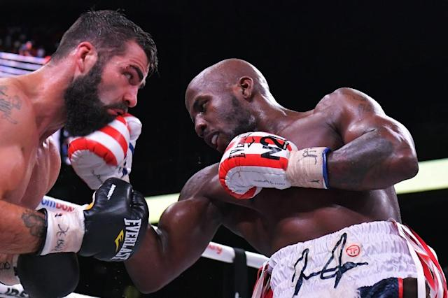 Tevin Farmer (R) and Jono Carroll exchange punches during the IBF Junior Lightweight World Championship at Liacouras Center (AFP Photo/Drew Hallowell)