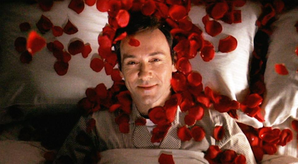 """LOS ANGELES - OCTOBER 1: The movie """"American Beauty"""", directed by Sam Mendes and written by Alan Ball.  Seen here, Kevin Spacey as Lester Burnham fantasizing about Angela Hayes on a bed of red rose petals.  Initial theatrical wide release October 1, 1999.  Screen capture. A Paramount Picture. (Photo by CBS via Getty Images)"""