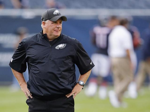 Philadelphia Eagles coach Chip Kelly watches his players warm up for an NFL preseason football game against the Chicago Bears on Friday, Aug. 8, 2014, in Chicago. (AP Photo/Charles Rex Arbogast)