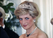 """FILE - In this Monday, Nov. 2, 1987 file photo, Britain's Diana, the Princess of Wales, is pictured during an evening reception given by the West German President Richard von Weizsacker in honour of the British Royal guests in the Godesberg Redoute in Bonn, Germany. For someone who began her life in the spotlight as """"Shy Di,"""" Princess Diana became an unlikely, revolutionary during her years in the House of Windsor. She helped modernize the monarchy by making it more personal, changing the way the royal family related to people. By interacting more intimately with the public -- kneeling to the level of children, sitting on edge of a patient's hospital bed, writing personal notes to her fans -- she set an example that has been followed by other royals as the monarchy worked to become more human and remain relevant in the 21st century. (AP Photo/Herman Knippertz, File)"""