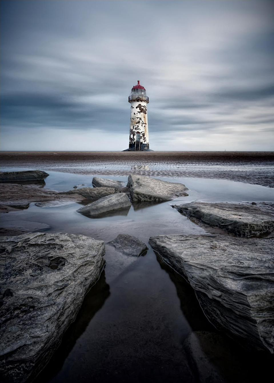 <p>This eerie landscape image of a lighthouse in Wales claimed first prize in the 'Coastal View' category. (Image: Rev Dr Richard Hainsworth)<br></p>