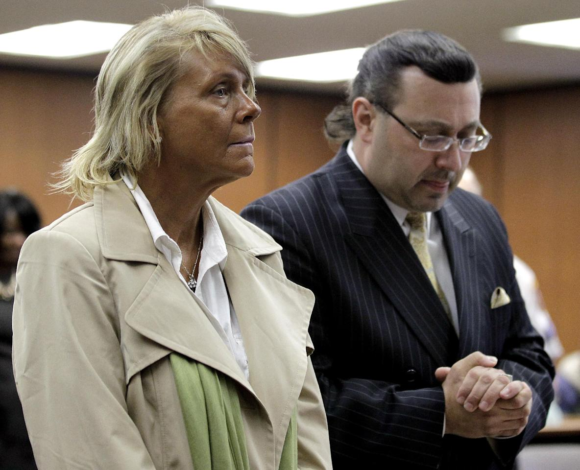 Patricia Krentcil, 44, left, stands with her lawyer John Caruso during a court appearance on charges of child endangerment at the Essex County Superior Court, Wednesday, May 2, 2012 in Newark, N.J. Krentcil is accused of taking her 5-year-old child into a tanning booth. Krentcil tells The Associated Press her daughter got her sunburn from being outside on a recent warm day. New Jersey state law prohibits anyone under 14 from using tanning salons.(AP Photo/Julio Cortez)