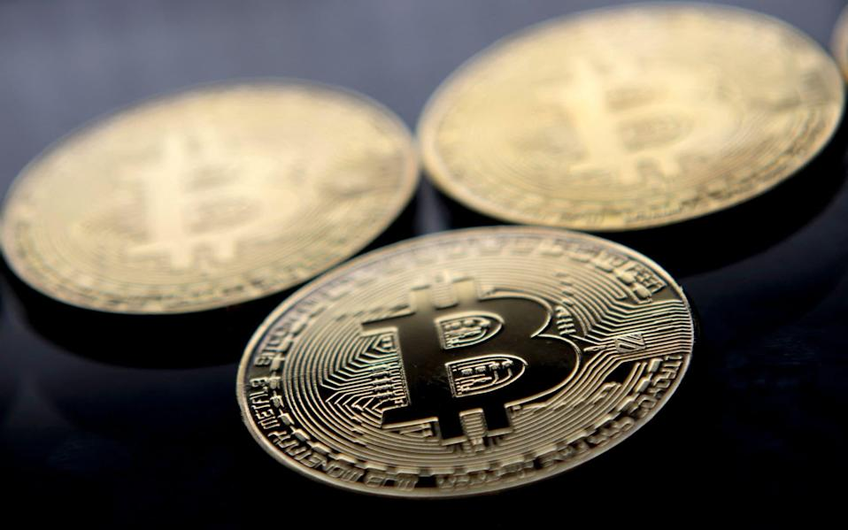 Bitcoin is now over 50pc off a $65,000 high in April - JUSTIN TALLIS/AFP