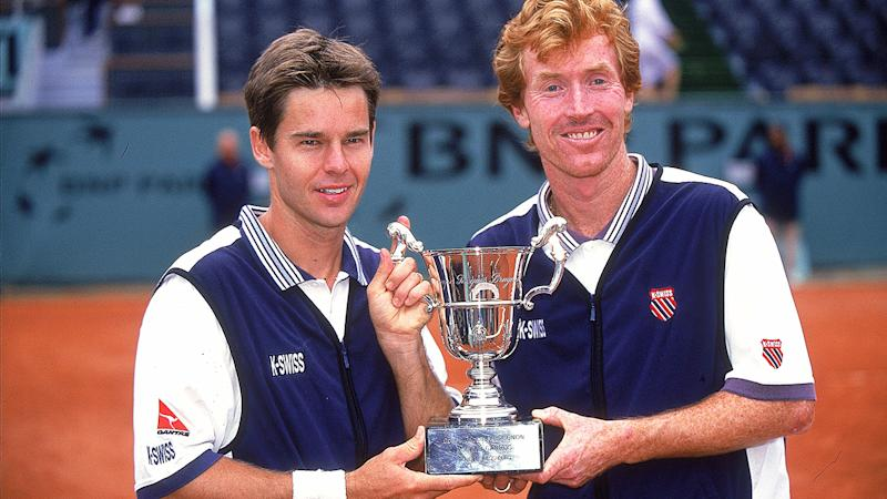 Todd Woodbridge and Mark Woodforde are pictured with the men's doubles trophy after their French Open win in 2000.