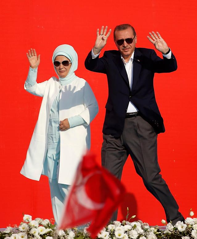 <p>Turkish President Recep Tayyip Erdogan, right, and his wife Emine wave to the crowd during a Democracy and Martyrs' Rally in Istanbul, Sunday, Aug. 7, 2016. A massive crowd of flag-waving supporters gathered in Istanbul Sunday for a giant rally to mark the end of nightly demonstrations since Turkey's July 15 abortive coup that left more than 270 people dead. (AP Photo/Emrah Gurel) </p>
