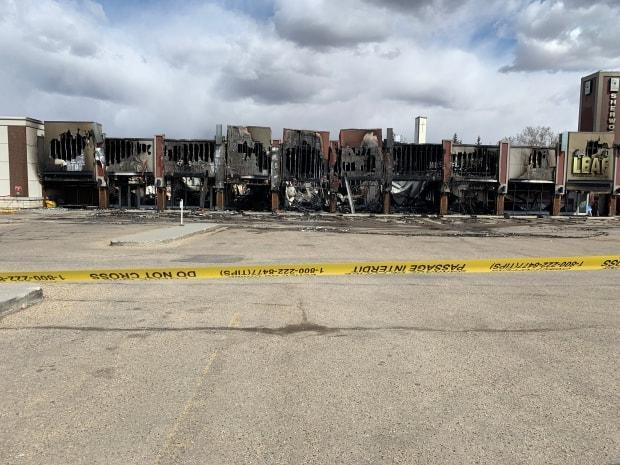 The cause of an overnight fire at the Sherwood Centre strip mall is still under investigation. (Scott Neufeld/CBC - image credit)