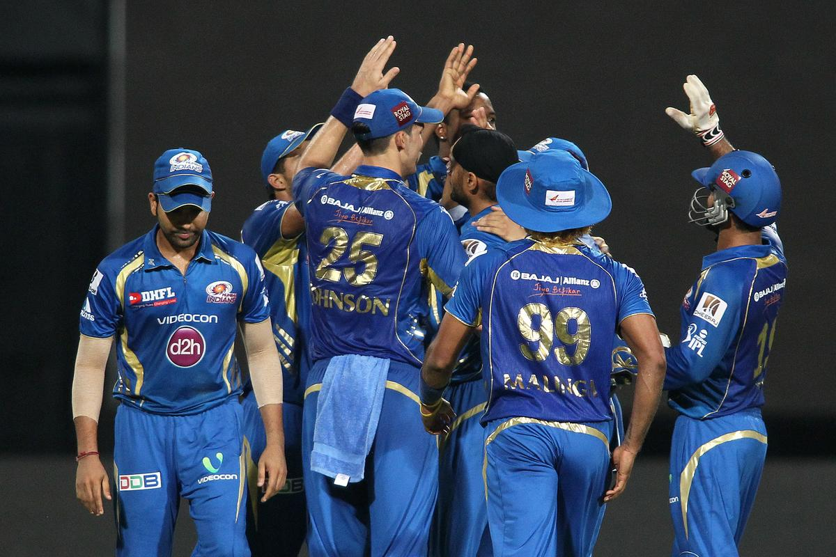 Kieron Pollard of Mumbai Indians and Harbhajan Singh of Mumbai Indians are congratulated for getting c12= wicket during the Final of the Pepsi Indian Premier League between The Chennai Superkings and the Mumbai Indians held at the Eden Gardens Stadium in Kolkata on the 26th May 2013..Photo by Saikat Das-IPL-SPORTZPICS       ..Use of this image is subject to the terms and conditions as outlined by the BCCI. These terms can be found by following this link:..https://ec.yimg.com/ec?url=http%3a%2f%2fwww.sportzpics.co.za%2fimage%2fI0000SoRagM2cIEc&t=1498659689&sig=9YmXM.E0bqVk4uuupJOC8Q--~C