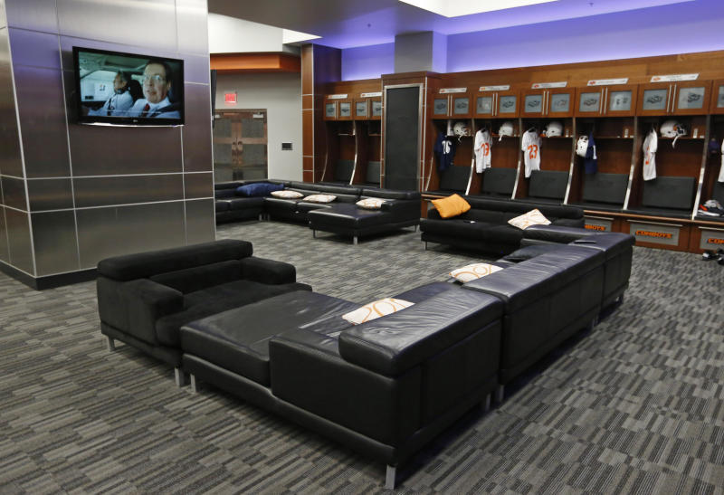 This Sept. 5, 2013 photo shows the Oklahoma State University football locker room in Stillwater, Okla. With weight rooms as big as football fields, more flat screen TVs than a Best Buy and enough leather furniture to fill Trump Plaza, players have no reason to go back to the dorms. (AP Photo/Sue Ogrocki)