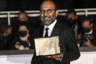 Asghar Farhadi, winner of the grand prix award for the film 'A Hero' poses for photographers during a photo call following the awards ceremony at the 74th international film festival, Cannes, southern France, Saturday, July 17, 2021. (Photo by Vianney Le Caer/Invision/AP)