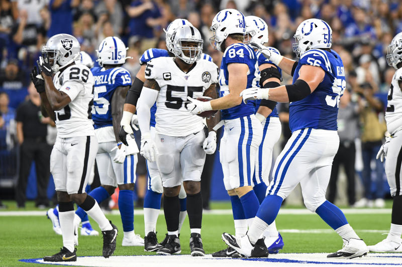 Oakland Raiders outside linebacker Vontaze Burfict (55) speaks with Indianapolis Colts tight end Jack Doyle (84) after his helmet-to-helmet hit on Doyle during the first half of an NFL football game in Indianapolis, Sunday, Sept. 29, 2019. Burfict has been suspended for the rest of the season for the hit. (AP Photo/Doug McSchooler)