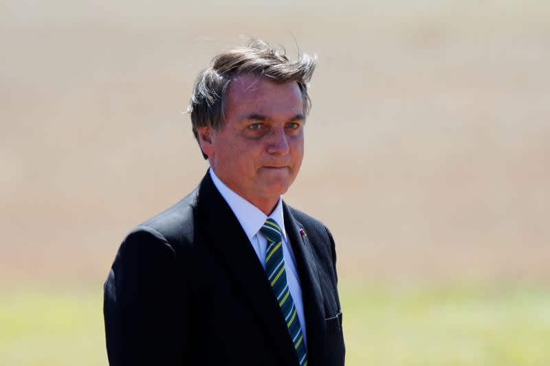 Bolsonaro plays down Amazon fires, accuses NGOs of blocking land titling