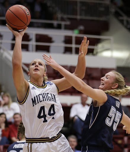 Michigan's Rachel Sheffer, left, shoots against Villanova's Emily Leer (55) during the first half of a first-round game in the women's NCAA college basketball tournament on Sunday, March 24, 2013, in Stanford, Calif. (AP Photo/Ben Margot)