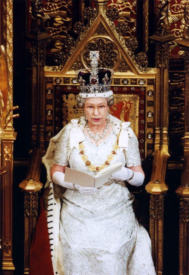 <p>Dressed in her full regalia, The Queen sits in the House of Lords for the state opening of parliament. (PA Archive) </p>
