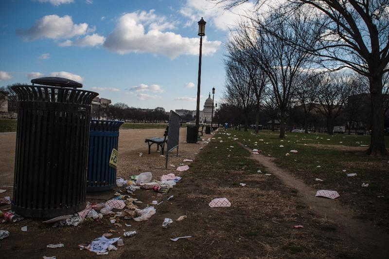 Litter spills out of a public dustbin on the National Mall in Washington as the US government shutdown goes into its third day (AFP Photo/Eric BARADAT)