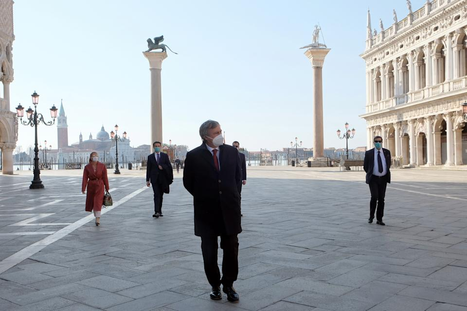 The mayor of Venice, Luigi Brugnaro, wears a protective mask as he walks in St Mark's Square on Easter Sunday, as Italy remains on lockdown due to a spread of the coronavirus disease (COVID-19), in Venice, Italy, April 12, 2020. REUTERS/Manuel Silvestri