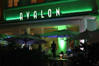 People dine outdoors at the Avalon Hotel along Ocean Drive, Friday, Sept. 24, 2021, in Miami Beach, Fla. The Avalon Hotel and its popular seafood restaurant downstairs is one of the iconic Art Deco hotels on South Beach from the 1940s. (AP Photo/Lynne Sladky)