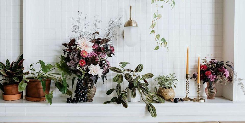 <p>Dress up a living room mantle with everything from brass candlesticks to an assortment of potted plants. Add color with small floral arrangements that embody the season.</p>