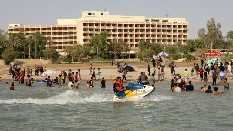 Iraqis swim and ride jet-skis on Lake Habbaniyah on June 17, 2012, during a brief revival of the resort before the Islamic State group moved into the area