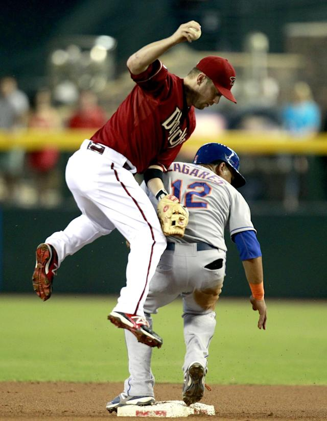 Arizona Diamondbacks second baseman Aaron Hill, left, tags out New York Mets' Juan Lagares (12) in the first inning during a baseball game on Sunday, Aug. 11, 2013, in Phoenix. (AP Photo/Rick Scuteri)