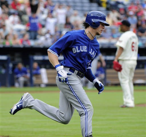 Toronto Blue Jays' Colby Rasmus rounds the bases on a home run off Atlanta Braves relief pitcher Livan Hernandez (61) in the sixth inning of a baseball game Sunday, June 10, 2012, in Atlanta. (AP Photo/David Tulis)