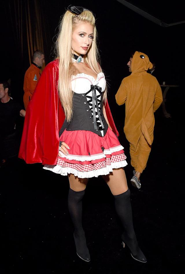<p>Per usual, the hotel heiress went as a sexy something! For the Casamigos party, she opted for naughty Little Red Riding Hood. (Photo: Michael Kovac/Getty Images) </p>