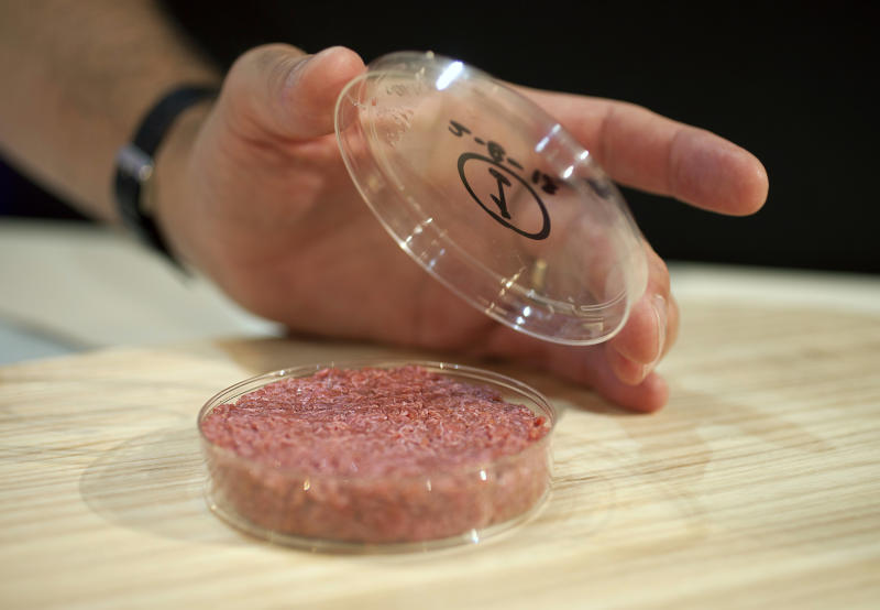 Professor Mark Post shows the world's first lab-grown beef burger during a launch event in west London August 5, 2013. The in-vitro burger, cultured from cattle stem cells, the first example of what its creator says could provide an answer to global food shortages and help combat climate change, was fried in a pan and tasted by two volunteers. The burger is the result of years of research by Post, a vascular biologist at the University of Maastricht, who is working to show how meat grown in petri dishes might one day be a true alternative to meat from livestock.The meat in the burger has been made by knitting together around 20,000 strands of protein that has been cultured from cattle stem cells in Post's lab. REUTERS/David Parry/pool (BRITAIN - Tags: ANIMALS ENVIRONMENT FOOD SCIENCE TECHNOLOGY) FOR EDITORIAL USE ONLY. NOT FOR SALE FOR MARKETING OR ADVERTISING CAMPAIGNS