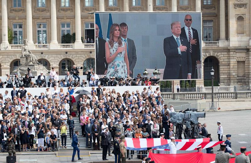 President Donald Trump and first lady Melania Trump are seen on a large screen as they stand during the U.S. national anthem during a Bastille Day parade in Paris on July 14, 2017. (Photo: Carolyn Kaster/ASSOCIATED PRESS)