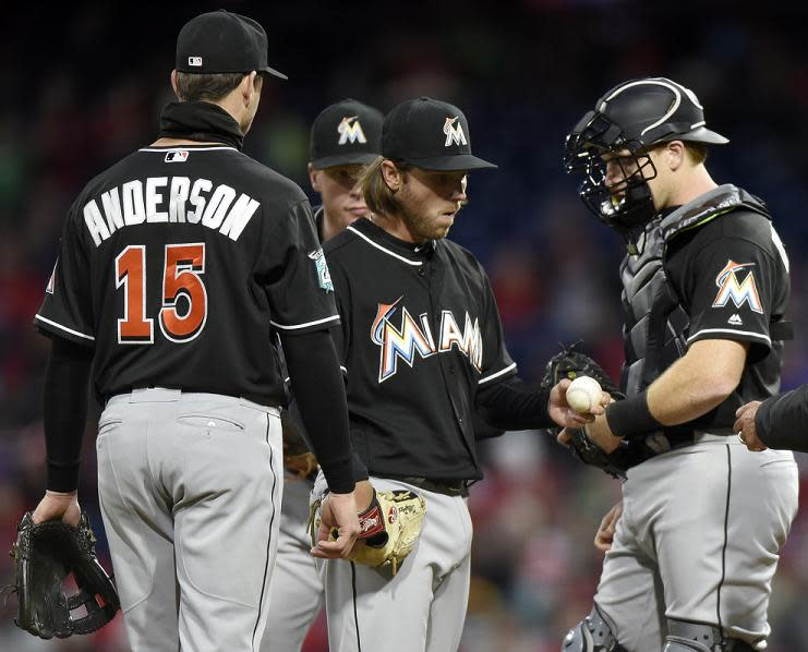 Marlins avoid sweep, spoil Arrieta's Phillies debut
