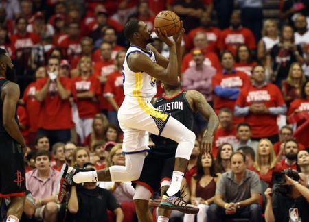 May 24, 2018; Houston, TX, USA; Golden State Warriors forward Kevin Durant (35) is defended by Houston Rockets forward PJ Tucker (4) during the first quarter in game five of the Western conference finals of the 2018 NBA Playoffs at Toyota Center. Mandatory Credit: Troy Taormina-USA TODAY Sports