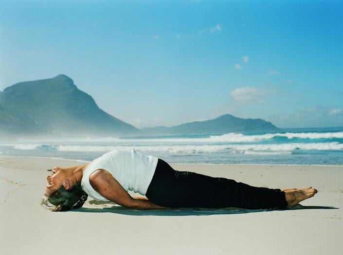 "Fish pose is an excellent tension reducer, and can also be therapeutic for fatigue and anxiety, <a href=""http://www.yogajournal.com/poses/786"" rel=""nofollow noopener"" target=""_blank"" data-ylk=""slk:according to Yoga Journal"" class=""link rapid-noclick-resp"">according to Yoga Journal</a>. To come into the pose, sit up on your hips with legs stretched out together in front of you and toes pointed. Bring your hands under your hips and lean back to prop yourself up on your forearms. Then, lift the chest above the shoulders and drop the head back to the ground behind you. Breathe deeply and rest in the pose for 15-30 seconds. Fish pose ""releases tension in the neck, throat, and head, helps stretch the chest muscles and opens up the lungs,"" Bielkus says."