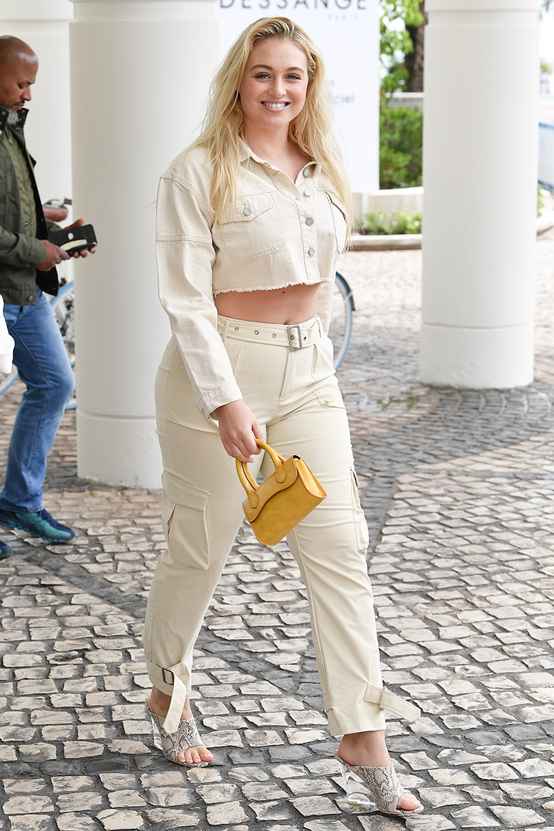<p>Iskra Lawrence makes the case for using a saffron-yellow bag to lift an ivory co-ord. Paired with snakeskin-print mules, it takes the look from pared-back to powered up.</p>