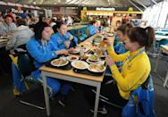 """<p>Per the International Olympic Committee, <a href=""""https://www.thrillist.com/culture/olympic-village-drinking-rules"""" rel=""""nofollow noopener"""" target=""""_blank"""" data-ylk=""""slk:drinking is allowed"""" class=""""link rapid-noclick-resp"""">drinking is allowed</a>. Athletes can even bring in their own alcohol to the Village. However, some athletes have no drinking rules imposed by their country. For the USA's athletes there's no booze in the Village but outside, it's fair game. </p>"""