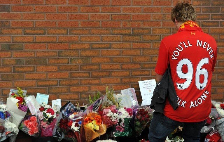 A fan pays his respects outside Anfield on September 23, 2012 to the 96 supporters who died in the Hillsborough disaster